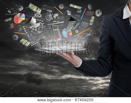 Businnes Concept. Woman Hand Hold Tablet Pc With Elements Of Business In The Light.