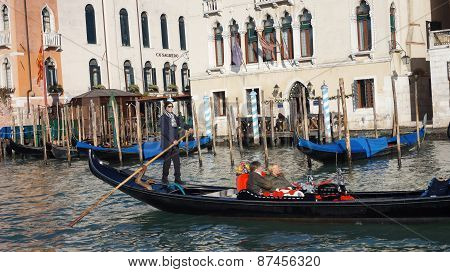 .tourists Travel On Gondolas At Canal In Venice, Italy.....