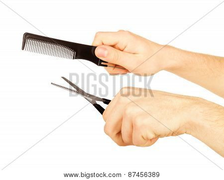 Male Hands Holding Scissors And Comb On White