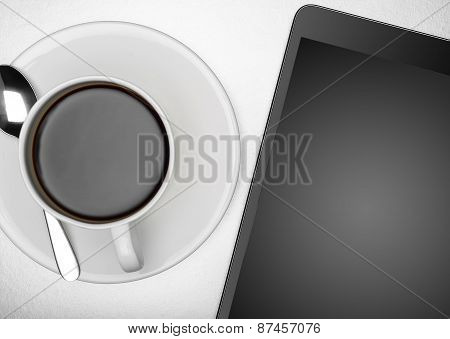 Tablet pc and cup of coffee