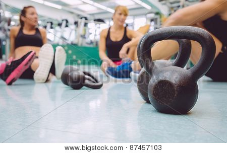 Black iron kettlebell on the floor of fitness center