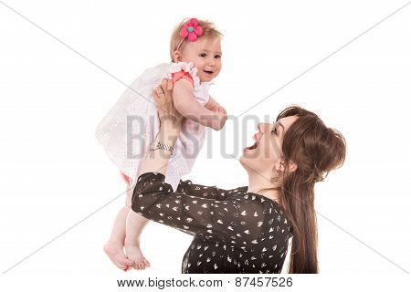 Mother Playing With Baby Girl