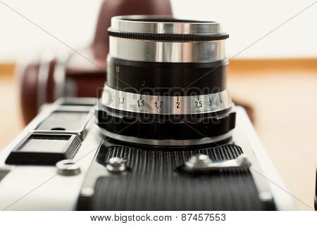 Closeup Photo Of Vintage Camera Lying On Wooden Desk