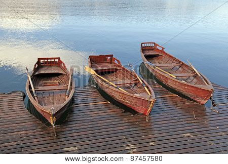 Wooden Boats On Picture Perfect Lake Bled, Slovenia.