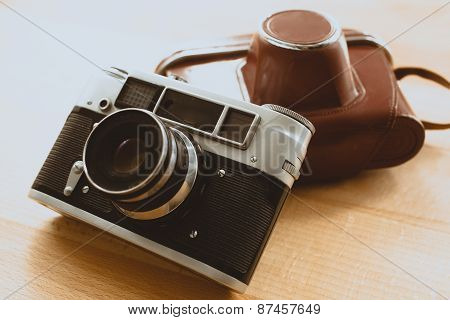 Toned Photo Of Retro Camera With Brown Leather Case