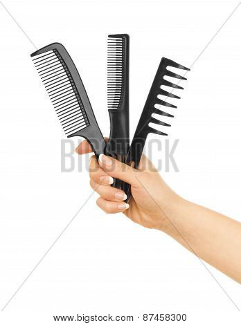 Combs In Her Hand Isolated On A White