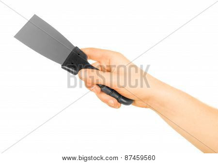 Hand Holding Trowel On A White