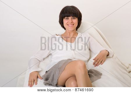 happy young beautiful woman relaxing on sofa at home