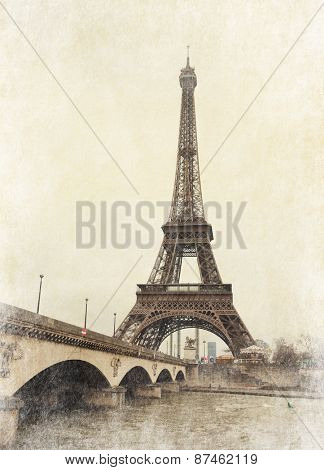 Eiffel tower view from Seine river, Paris, France. Photo in retro style.  Added paper texture