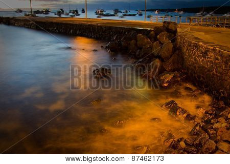 View of pier in San Cristobal island, Galapagos, during sunset