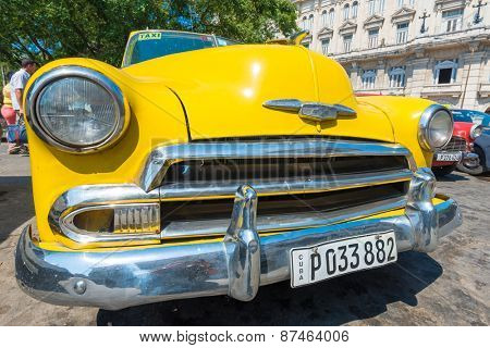 HAVANA,CUBA - APRIL 3, 2015 : Colorful vintage american car , a symbol of Old Havana