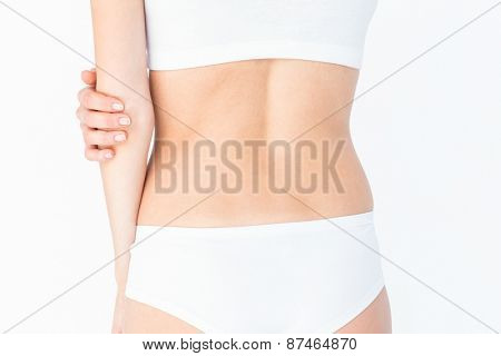Woman suffering from elbow pain on white background
