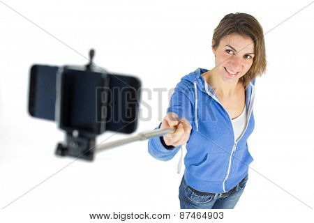 Casual brunette taking a selfie shot in studio