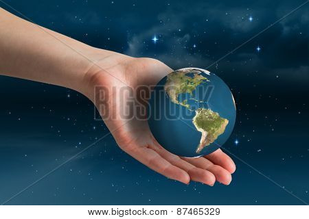 Hand presenting against stars twinkling in night sky