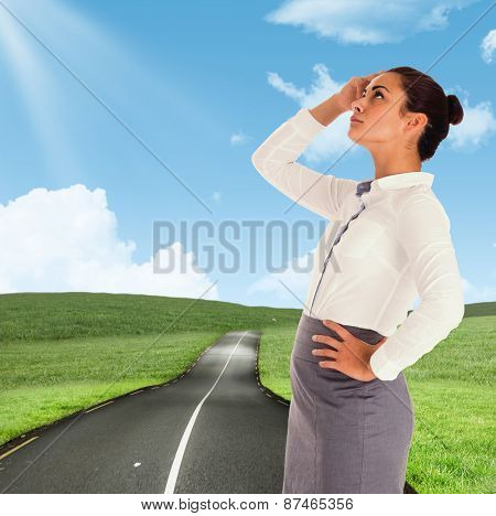 Focused businesswoman against road leading out to the horizon