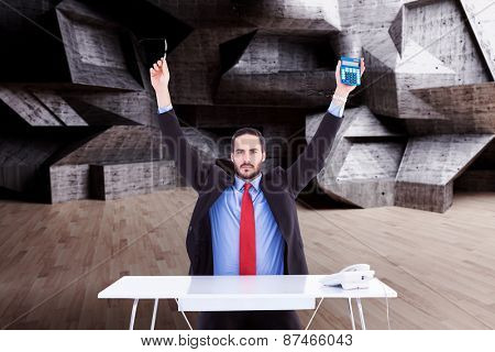 Businessman holding up reading glasses and calculator against abstract room
