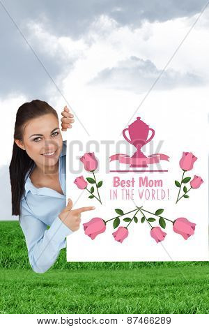 Smiling businesswoman looking around the corner while pointing against field and sky