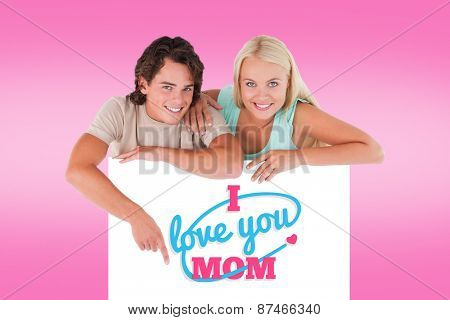 Handsome Man pointing on a whiteboard with woman against pink