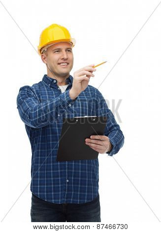 repair, construction, building, people and maintenance concept - smiling male builder or manual worker in helmet with clipboard taking notes