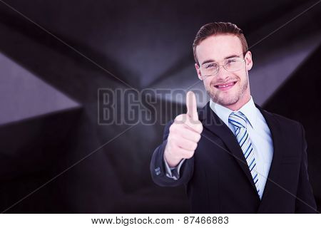 Positive businessman smiling with thumb up against abstract black room