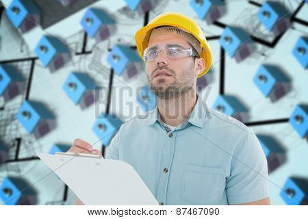 Supervisor looking away while writing on clipboard against blue 3d houses in an estate order