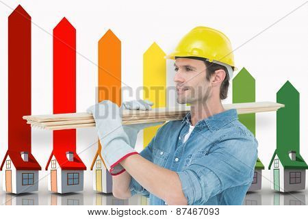 Carpenter carrying wooden planks over white background against seven 3d houses representing energy efficiency