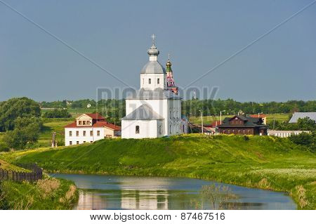 Orthodox Church On The Green Lawn Near The River, The City Of Suzdal Russia