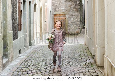 Running little girl with white roses