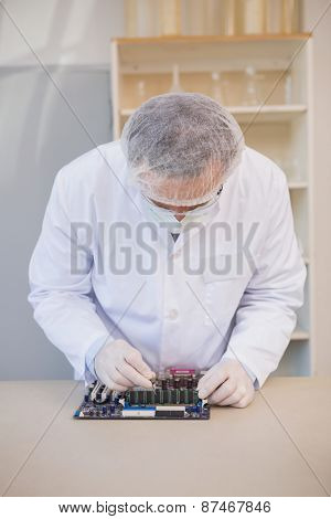 Engineer working on broken cpu in the laboratory