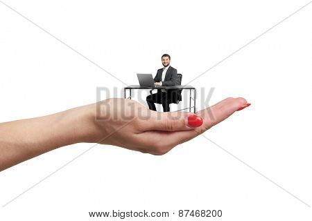 big female palm holding small man at table with computer. isolated on white background