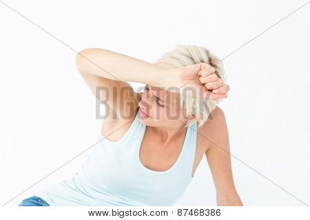 Depressed woman on the floor on white background