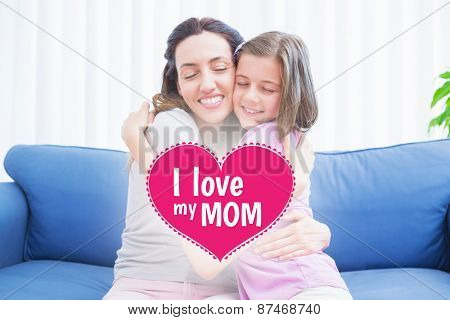 mothers day greeting against mother and daughter hugging on couch