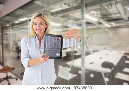 Mature student showing tablet pc against classroom