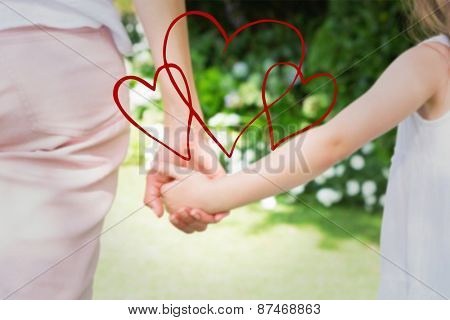 hearts against mother and daughter holding hands
