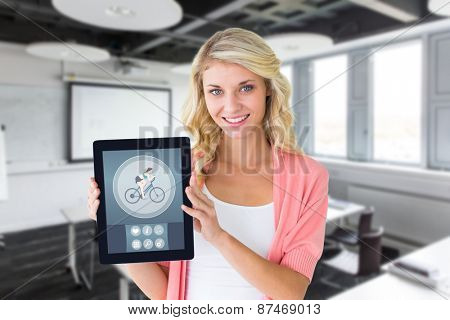 Young pretty student showing tablet pc against classroom