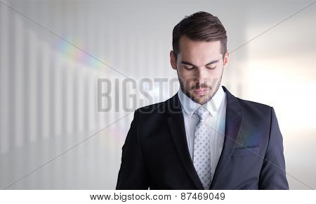 Concentrated businessman using magnifying glass against white curved room