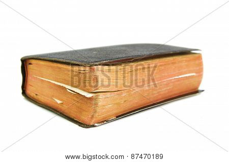 Old book with slightly unfocused back on a white background