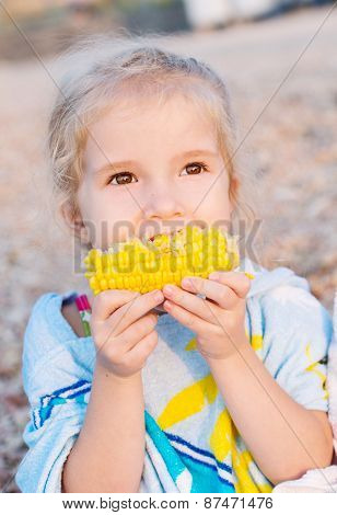 Toddler Cute Girl Eating Boiled Corn