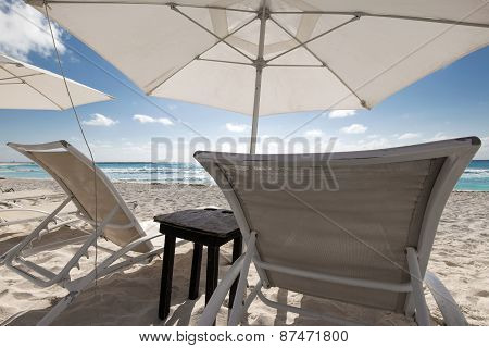 Beach With Sun Umbrellas And Beds