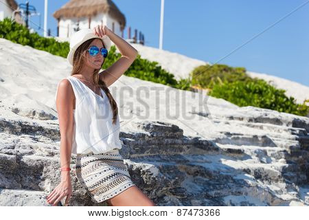 Tanned Woman In Sunglasses On Beach