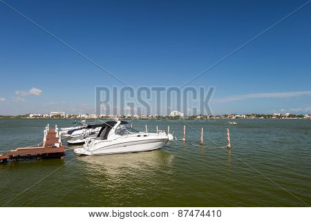 Speedboats Moored To A Jetty