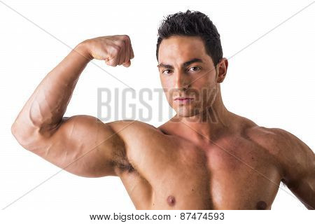 Handsome bodybuilder doing bicep pose, isolated on white