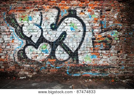Urban Brick Wall With Grungy Chaotic Graffiti