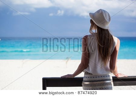 Woman On Balcony Looking To The Seascape