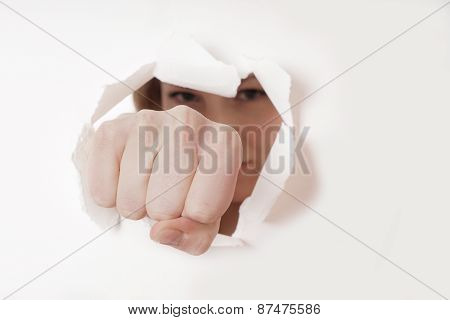 fist punching hole
