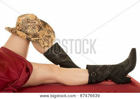 Woman Legs Red Sheet With Cowboy Hat On Knee And Boots