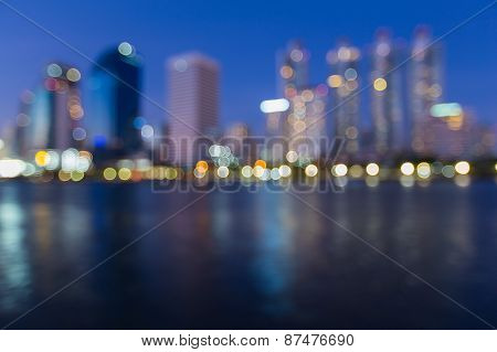 Out of focus cityscape at night time, Blurred Photo bokeh with water reflection