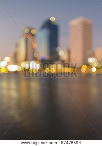 City light out of focus before sunset with water relfection