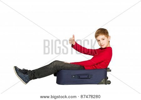 Boy Sitting On Travel Bags Holding Showing Thumb Up