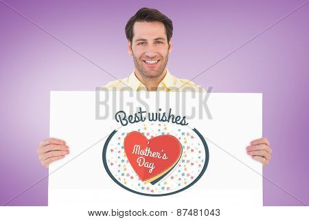 Attractive man smiling and holding poster against purple vignette